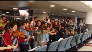 What happens when an orchestra is stranded at the airport?