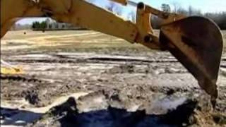 How to Operate a Backhoe : How to Operate the Back Boom on a Backhoe
