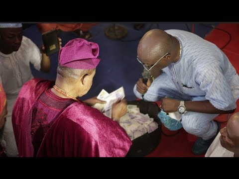 Adewale Ayuba Bow Down As Alaafin Of Oyo Shower Him With Bundle Of Money At His Daughter Wedding