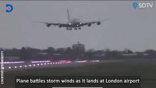 Plane lands sideways as it battles strong winds in London