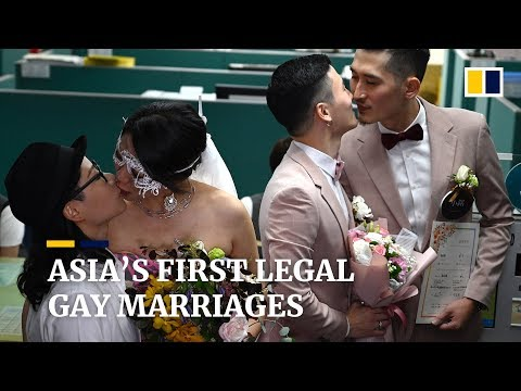 Taiwan holds Asia's first legal gay weddings, in a boost for LGBT communities