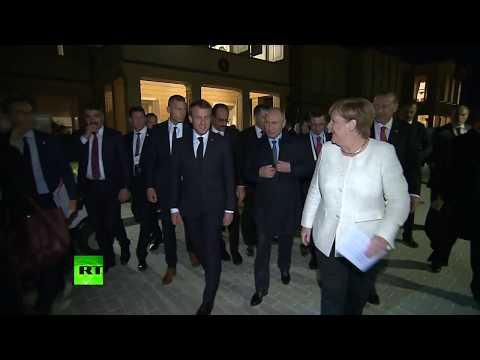 'Siberian coat?' Merkel tries out her Russian on Putin