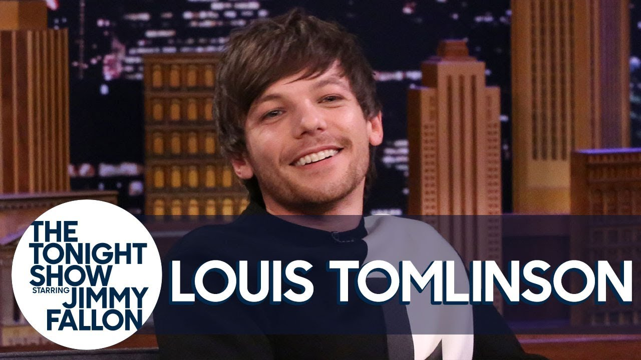 Louis Tomlinson Reacts to Home Footage of Himself Starring as Danny Zuko in Grease thumbnail
