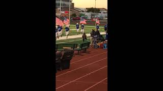 Fruita Monument Wildcat Football Team Waving American Flags