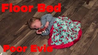 EVIE MAKES A BED ON THE KITCHEN FLOOR