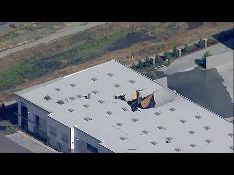 Military and civilian investigators are on the scene where an F-16  fighter jet crashed Thursday into a warehouse in southern California. The pilot ejected safely and officials said there were no serious injuries to warehouse workers. (May 17)