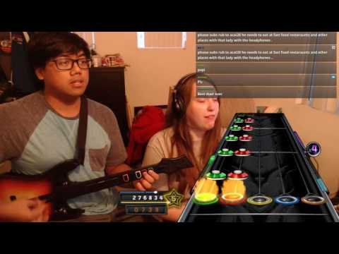 This guy jamming out to Guitar Hero with his girlfriend is one of the most wholesome things I've seen in a while