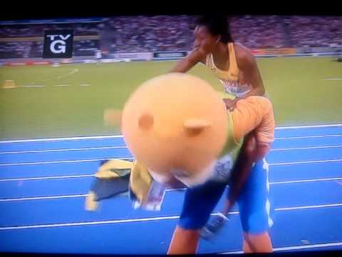 Melaine Walker is getting a piggy back ride from the games mascot whom crashes into something sending them both flying