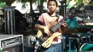 11 Year old bass player throwing down the FUNK in a concert in the park