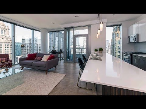 A skyline-view 1-bedroom model at the Loop's luxurious MILA apartments