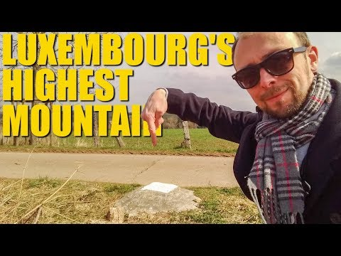 Guy climbs to the highest peak in Luxembourg