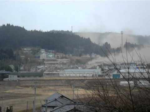 Watch People Take To A Hill To Escape Tsunami's Destruction