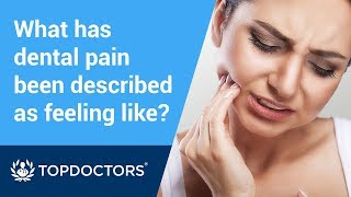What has dental pain been described as feeling like?