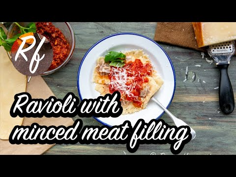 Homemade raviolis filled with minced meat ragu Bolognese-style served with parmesan cheese, tomatosauce and basil. >