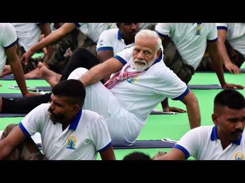 India's Prime Minister Narendra Modi practiced yoga alongside an estimated 40,000 people at an event Friday for International Yoga Day. (June 21)