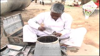 An old man making traditional bucket