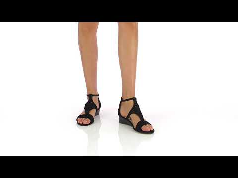 Sandale compensée noire en cuir perforé