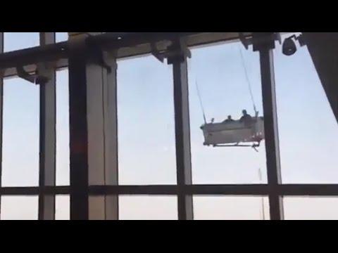 , title : 'Сильный ветер превратил в кошмар смену работников клининговой компании в Шанхае'