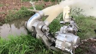 Máy bơm nước  bằng động cơ xe may