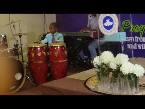 3 years old boy on conga drum during praise and worship