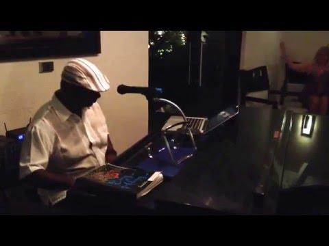 Dale Husbands singing Piano Man at Sandals Barbados