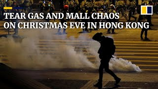 Hong Kong marks Christmas Eve with tear gas on streets and protest chaos in malls