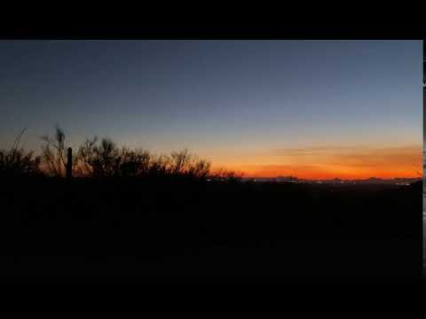 View of the cacti and sunset over Tucson. This is shot from the front of our site, where the car is parked.