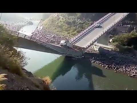 Miraculous escape after bridge collapses breaks in two