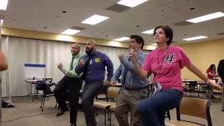 Software Engineers and a teacher dancing to GoNoodle.com