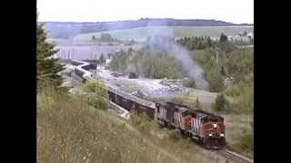CN#701  two GP40-2(W)s & HR-616 depart mine with loaded gypsum train 1 Sept 1995.
