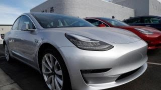 Tesla hits Model 3 production target