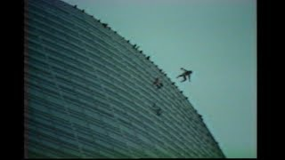 Man parachutes from Allied Bank Building 1983