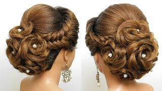 Bridal Hairstyle For Long Hair. Wedding Updo  With Bun Of Braided Flowers