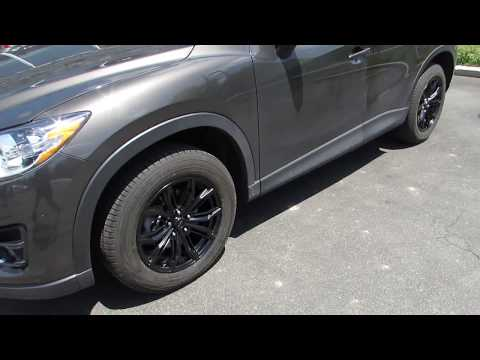 2015 MAZDA CX5 WITH 17 INCH BLACK CUSTOM RIMS & TIRES