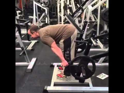 Stiff leg deadlift on deadlift machine