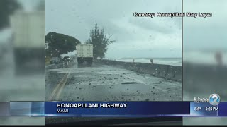 Waves crash onto Honoapiilani Highway from high surf and high tides