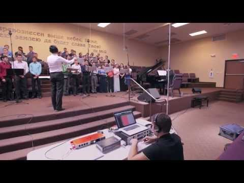 Joseph conducts an original choral composition for a recording in California.