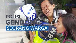 Video Viral Anggota Polantas Gendong Seorang Pria yang Mengalami Sakit Jantung