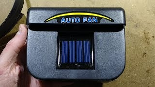Inside a solar powered car window ventilator.