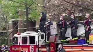 "FDNY firefighter plays ""The Star Spangled Banner"" in tribute to health care workers 