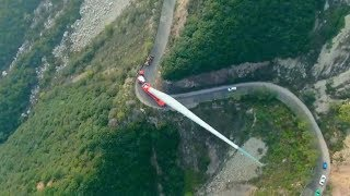 How are wind turbine blades transported to mountains?