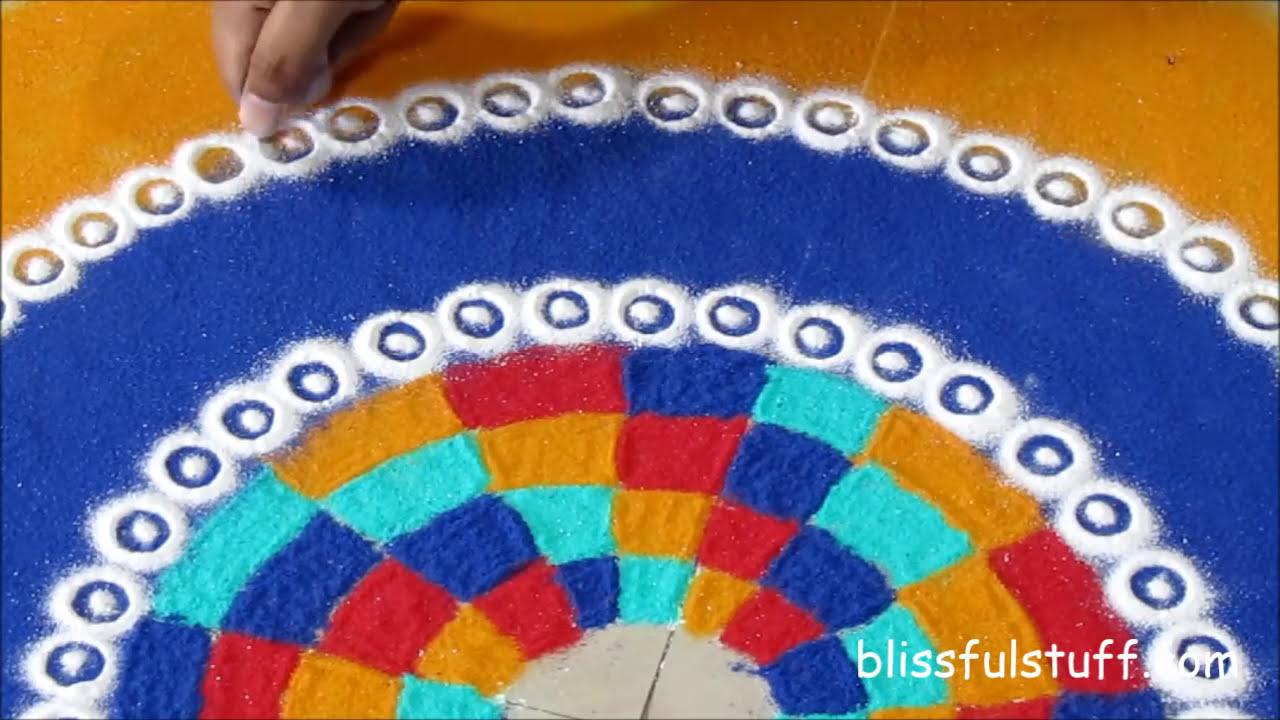beautiful and unique multicolored rangoli design by poonam borkar
