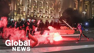 Tensions high after thousands of protesters storm Serbian parliament over planned lockdown