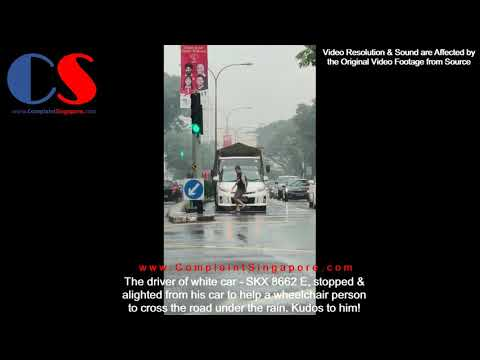 Driver Helped Wheelchair Person To Cross The Road Under Rain