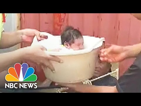 Resourceful Rescuers Use Bucket to Save Baby From Peru Floods | NBC News