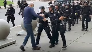 video: George Floyd protests: Police officers suspended after shoving 75-year-old man to the ground