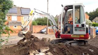 8 Year Old Boy Operating A Takeuchi Mini Excavator / Digger
