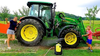 Playing in the mud and watering GIANT TRACTOR with Pressure Washer and Mommy Video for Kids