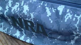 NRA CAMO BAG AND THE  ARE YOU A LOSER GAME.