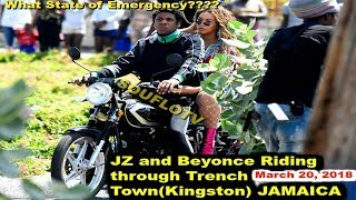 Jay Z and Beyonce riding through Bob Marley Trench Town Kingston Jamaica